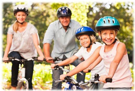 parents and children on bicycles